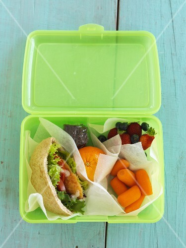 A chicken pita, fruit and vegetables in a lunchbox