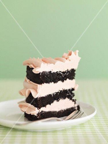 A chocolate cake with rose creme filling