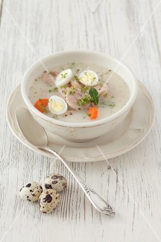 Zurek (Polish sour rye soup) with sausage and quail's eggs
