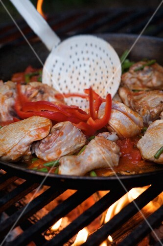 Paella in a large pan on an open fire