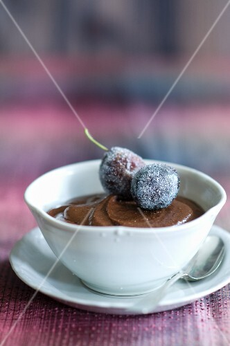 Chocolate Mousse in a Porcelain Bowl with Sugared Plum Garnish