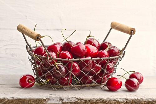 Cherries in a wire basket