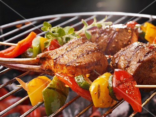 Vegetable kebabs and ribs on a barbecue