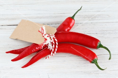 A bunch of red chilli peppers with a label