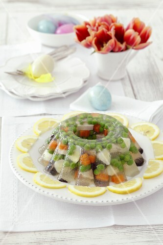 Chicken, quail's eggs, peas, olives and carrots in aspic