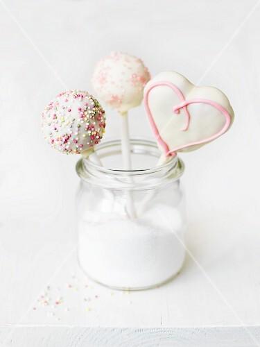 Cake pops in a jar of sugar