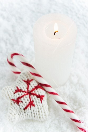 A candle, a candy cane and a knitted star