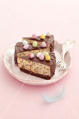 Three slices of cheesecake, chocolate chips and sugar eggs