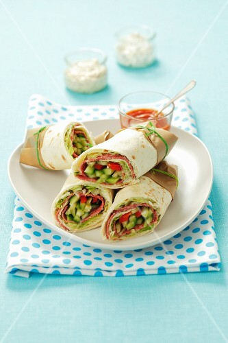 Wraps and salami and vegetables