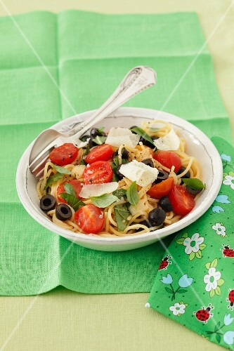 Spaghetti with cherry tomatoes, black olives, basil and Parmesan