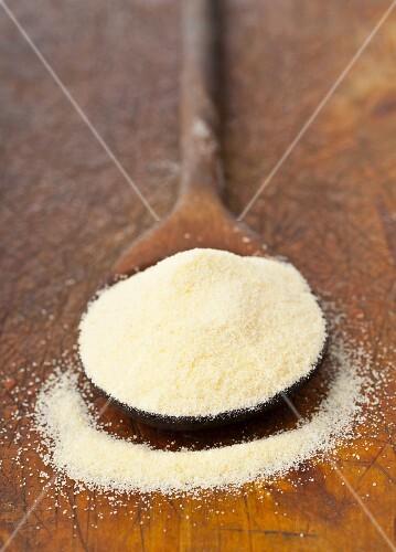 Durum wheat semolina on a wooden spoon