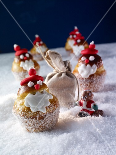 Brioche decorated as Father Christmases