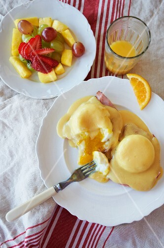 Eggs Benedict with Fruit Salad and Orange Juice; From Above