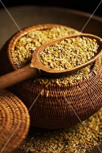 Wooden Scoop and Basket of Freekeh