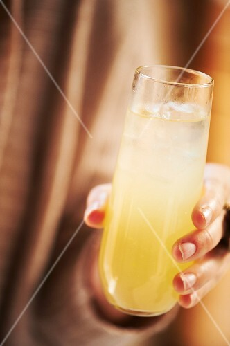 Woman Holding a White Wine Cocktail