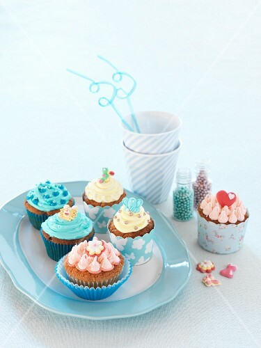 Various cupcakes with colourful decorations