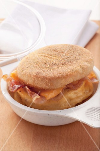 Bacon and melted cheese in an English muffin
