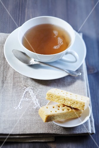 A cup of tea and shortbread on a napkin