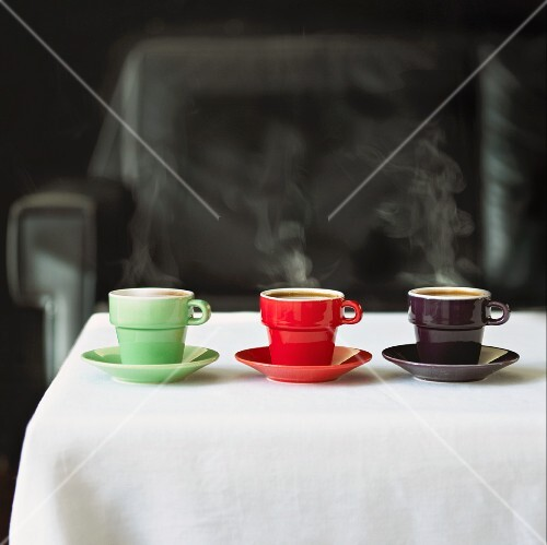Green, red and black cups on a table