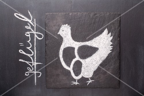 A sketch of a chicken on a chalkboard