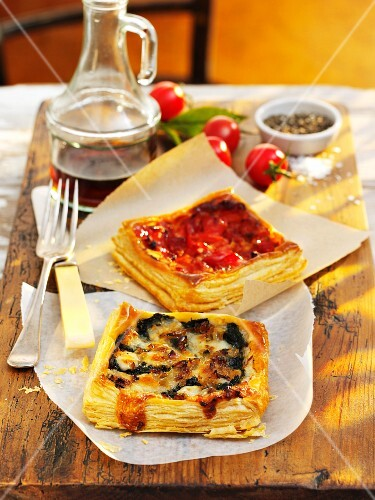 Spicy puff pastry tarts on a wooden board