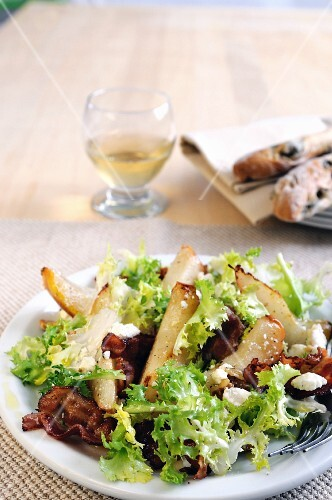 Frisee lettuce salad with pear, feta and fried Pancetta
