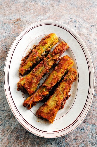 Stuffed, fried celery on a plate