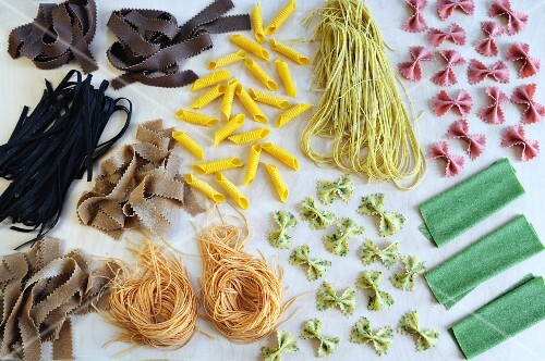 An arrangement of various colourful types of pasta