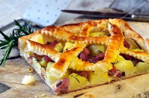 A slice of lattice potato and ham pie