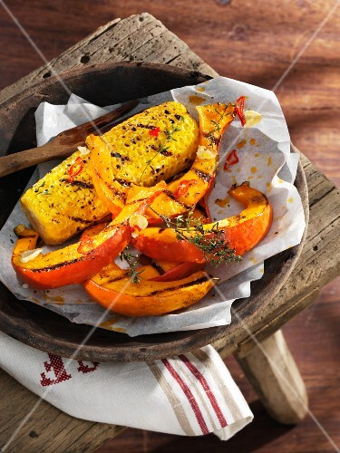 Grilled pumpkin and corn cobs