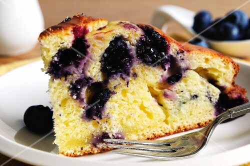 A slice of ricotta and blueberry cake (close-up)