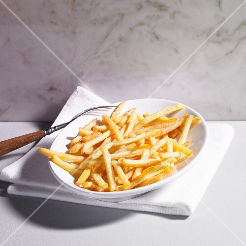 A plate of chips with a fork