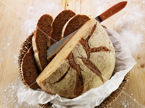 Sliced country bread in a bread basket