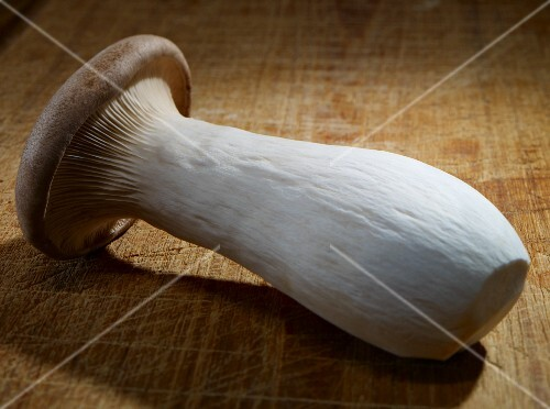 A king trumpet mushroom on a chopping board