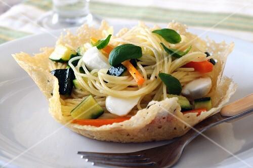 Pasta primavera in a Parmesan basket