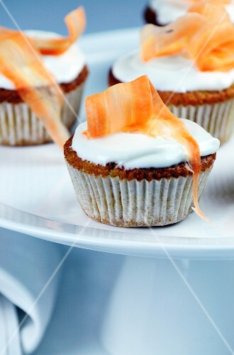Carrot cupcakes topped with cream cheese