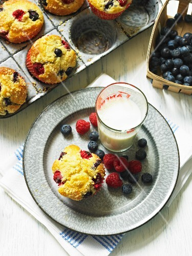 Berry muffins and glass of milk