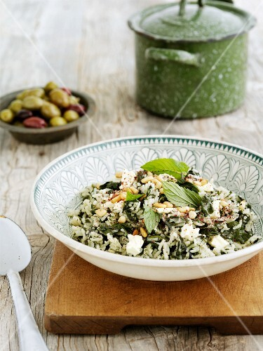 Rice salad with spinach, feta cheese and mint