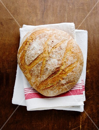 Boule (French white bread) on a tea towel
