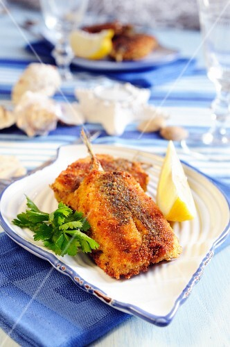 Stuffed and breaded fillets of anchovies