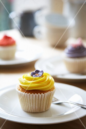 A lemon cupcakes and other cupcakes in the background