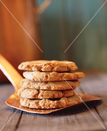 Stack of Gluten-Free Ginger Cookies on a Spatula
