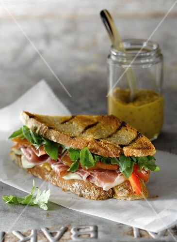 Grilled Prosciutto and Cheese Sandwich with Roasted Red Peppers and Arugula