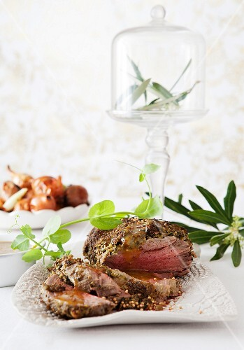 Roast beef with an olive and mustard crust for Christmas dinner