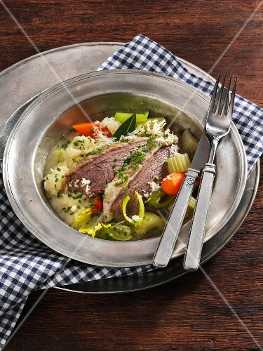Prime boiled beef with horseradish, mashed potatoes and vegetables