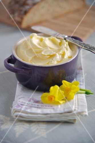 Freshly made butter in a ceramic pot