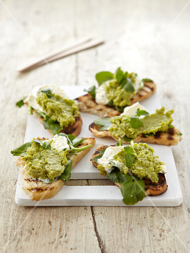 Bruschetta topped with bean purée and goat's cheese
