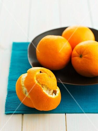 Oranges, whole and peeled