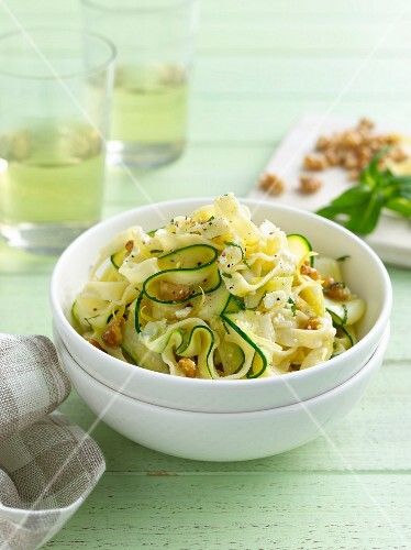 Bowl of pasta with sliced zucchini