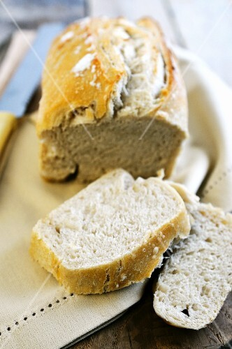 A loaf of white bread, sliced